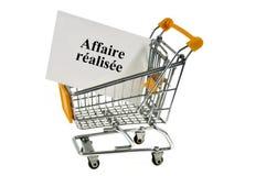 Biznesowy pojęcie robić z wózkiem na zakupy na białym tle obraz stock