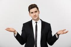 Biznesowy pojęcie: Portreta biznesmena punktu przystojne młode ręki na stronie opróżniać kopii przestrzeń Pojęcie reklama obraz royalty free