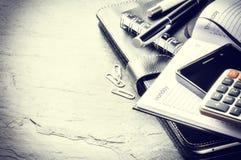 Biznesowy pojęcie z agendą, telefonem komórkowym i kalkulatorem, Obraz Stock