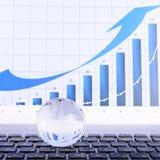 biznesowy pojęcie szklana kula ziemska na laptop klawiaturze Zdjęcie Royalty Free