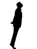 biznesowy przyglądający mężczyzna jeden sylwetki tiptoe jeden Zdjęcia Royalty Free