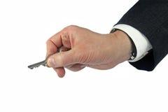Biznesowa ręka trzyma klucz Fotografia Stock