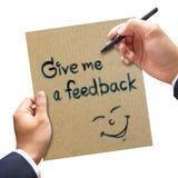 Biznesowy ręki writing Daje ja informacje zwrotne na papierze Fotografia Royalty Free