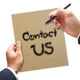 Biznesowy ręki writing kontakt My na papierze zdjęcia royalty free