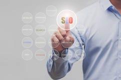 Biznesowy ręka seansu rewizi SEO ikony sieci komunikacyjny znak jak Obrazy Stock