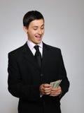 biznesowych wyrażeń przystojni mężczyzna pieniądze potomstwa Obrazy Royalty Free