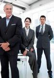 bizneswomanów koledzy jej rząd fotografia stock