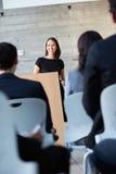 Bizneswoman Dostarcza prezentację Przy konferencją Obraz Royalty Free