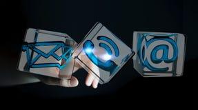 Bizneswoman dotyka przejrzystą sześcianu kontaktu ikonę z jej fi Zdjęcie Stock