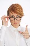 Bizneswoman Jest ubranym szkła i Wskazuje palec Fotografia Stock