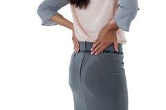 Bizneswoman ma backache zdjęcie royalty free