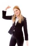 Bizneswoman napina jej bicepsy zdjęcia stock