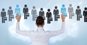 Bizneswoman oddziała wzajemnie osoby i wybiera od grup ludzi ikon Zdjęcie Royalty Free
