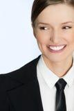 Bizneswoman ono uśmiecha się - zamknięty portret kobieta Zdjęcie Stock