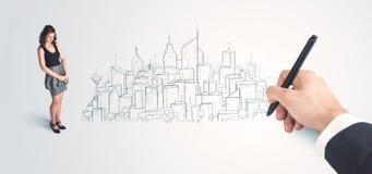 Bizneswoman patrzeje gotowego rysującego miasto na ścianie Obraz Royalty Free