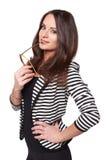 Bizneswoman patrzeje z szkłami w jej wargach Fotografia Royalty Free