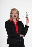 Bizneswoman patrzeje zaskakujący Zdjęcia Stock