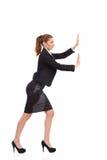 Bizneswoman pcha ścianę obraz stock