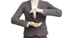 Bizneswoman pokazuje coś na odosobnionym białym tle zdjęcie stock