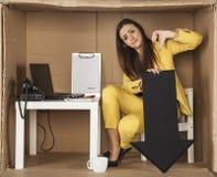 Bizneswoman pokazuje kciuka puszek Zdjęcie Royalty Free