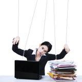 Bizneswoman pracuje jak marionetka Obraz Stock