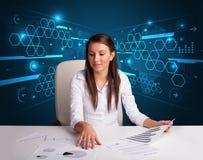 Bizneswoman robi papierkowej robocie z futurystycznym tłem Obraz Stock