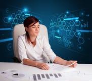 Bizneswoman robi papierkowej robocie z futurystycznym tłem Fotografia Stock