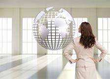 Bizneswoman trwanie kamera z powrotem Obraz Stock