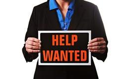 Bizneswoman trzyma pomoc chcieć znaka Zdjęcia Royalty Free