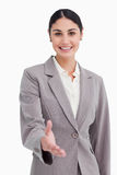 Bizneswoman uśmiechnięta ofiara jej ręka Zdjęcie Stock