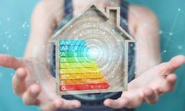 Bizneswoman używa 3D renderingu oceny energetyczną mapę w drewnianym Zdjęcie Stock