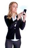 Bizneswoman używa telefon komórkowy Fotografia Royalty Free