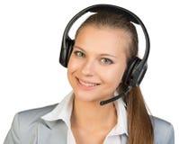 Bizneswoman w słuchawki, patrzeje kamerę obrazy royalty free