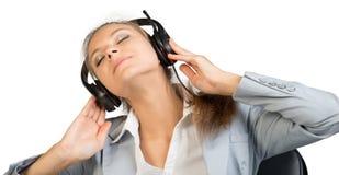 Bizneswoman w słuchawki Zdjęcia Stock