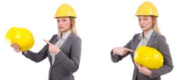 Bizneswoman w szarość nadaje się i zbawczy hełm odizolowywający na bielu Zdjęcia Royalty Free