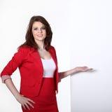 Bizneswoman wskazuje przy pustą przestrzenią Zdjęcie Stock