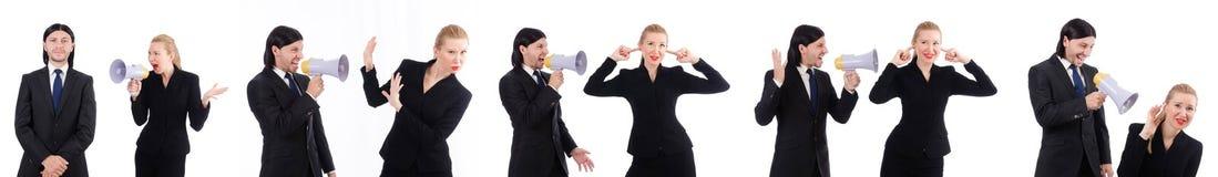 Bizneswoman z megafonem odizolowywającym na bielu i biznesmen Fotografia Royalty Free