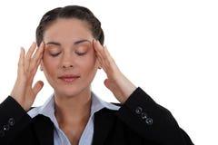 Bizneswoman z migreną zdjęcie royalty free