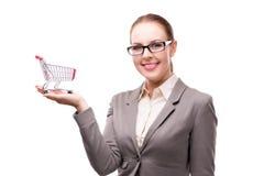 Bizneswoman z wózek na zakupy tramwajem odizolowywającym na bielu Zdjęcie Stock