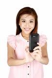 bizneswomanu azjatykci telefon używać potomstwo Fotografia Royalty Free