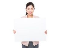 Bizneswomanu chwyt z puste miejsce deską Zdjęcie Stock