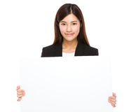Bizneswomanu chwyt z puste miejsce deską Fotografia Stock