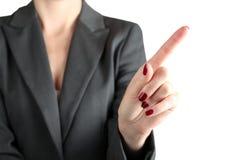 Bizneswomanu macanie coś palcem Zdjęcia Stock