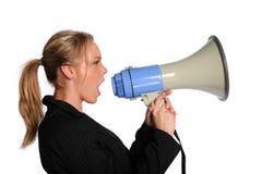 bizneswomanu megafonu krzyczący potomstwa fotografia stock