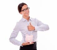 Bizneswomanu mienia menchii porcelany prosiątka bank Zdjęcie Stock