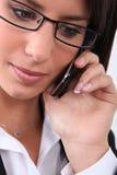 bizneswomanu mienia przenośny telefon Fotografia Royalty Free