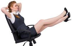 Bizneswomanu obsiadanie na swivel krześle Zdjęcie Royalty Free