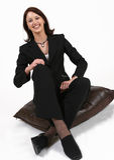 bizneswomanu posiedzenie odprężona Obrazy Royalty Free
