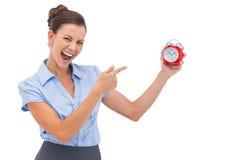 Bizneswomanu wskazujący budzik Zdjęcie Royalty Free