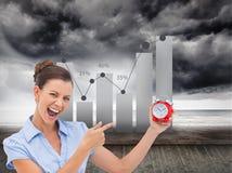 Bizneswomanu wskazujący budzik Obraz Stock